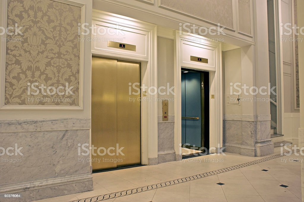 View of two elevators in which one is closed and other open royalty-free stock photo