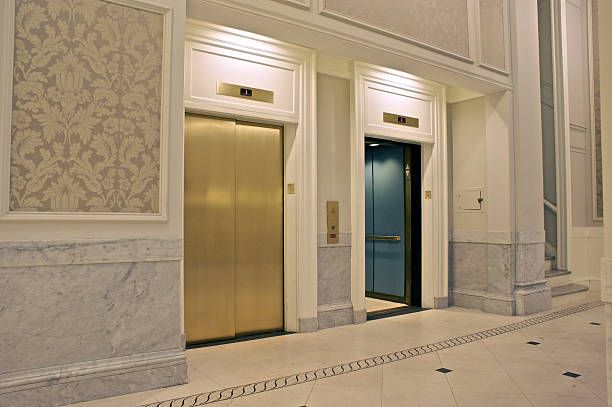 View of two elevators in which one is closed and other open stock photo