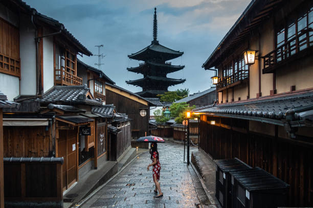 View of typical street in Higashiyama district of Kyoto with a girl and Yasaka pagoda stock photo