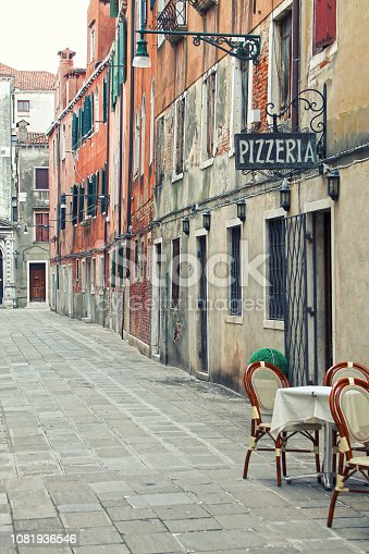 View of street in Venice. Detail of typical  pizzeria in Venice. Italy.
