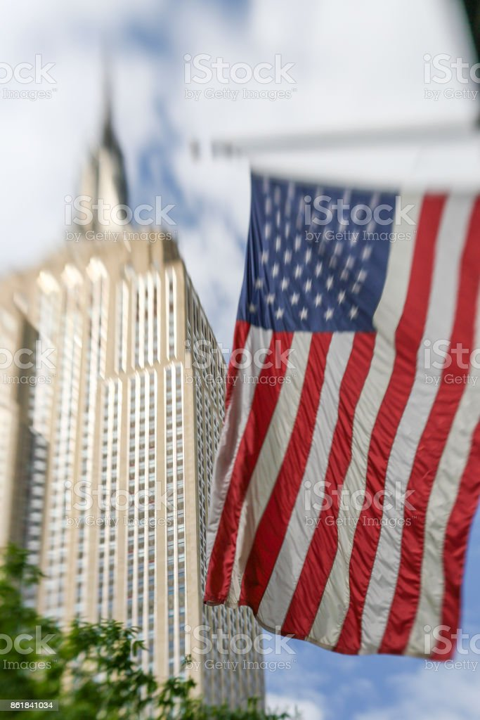 View of USA flag and Empire State Building stock photo