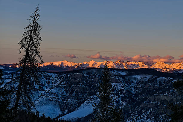 View of Vail Back Bowls and Gore Range Mountains View of Vail Back Bowls and Gore Range Mountains - Scenic views with dramatic alpenglow late afternoon sunset light.  Vail, Colorado USA. minturn colorado stock pictures, royalty-free photos & images