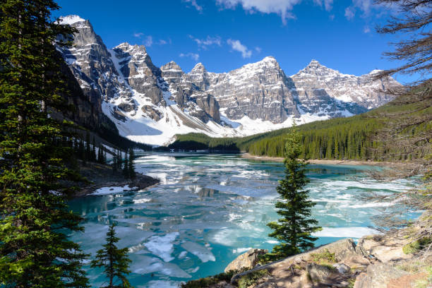 view of valley of the ten peaks moraine lake with blue sky in springs, banff national park, alberta, canada - banff national park stock photos and pictures