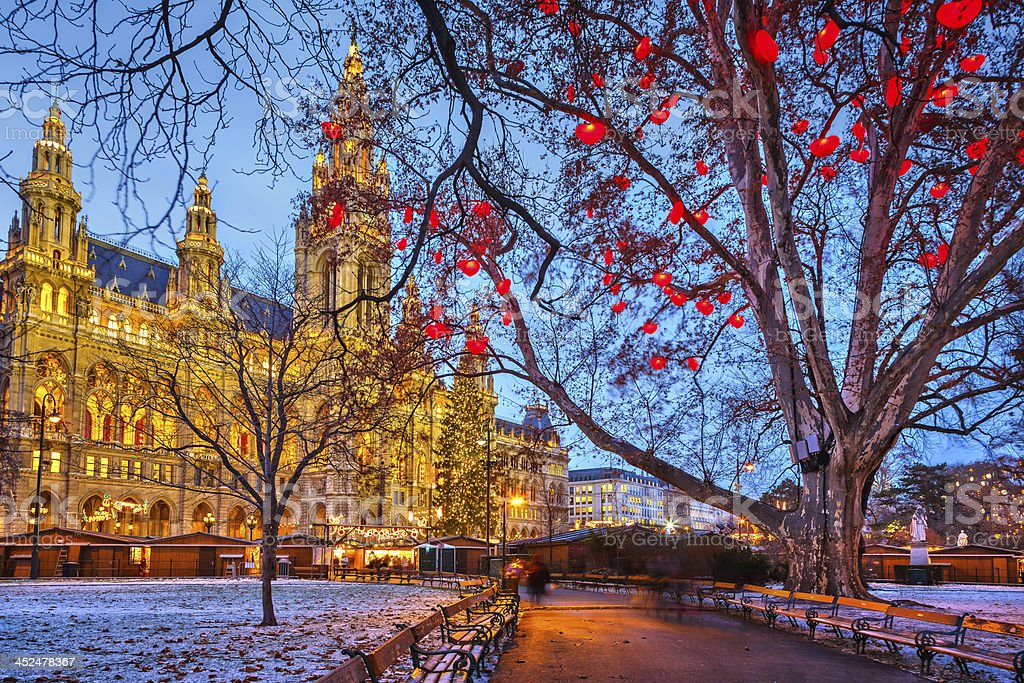 View of Vienna town hall behind bare tree branches  stock photo