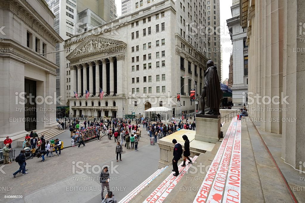 View of Wall street with New York Stock Exchange stock photo