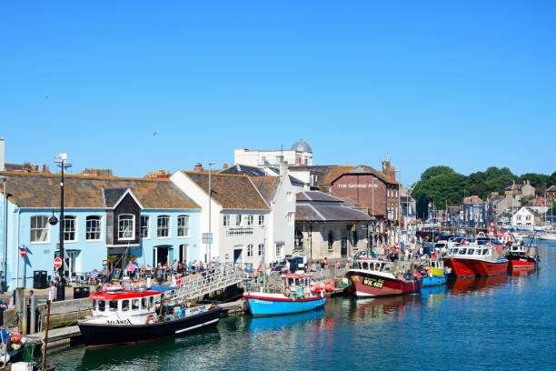 view of weymouth harbour. - weymouth stock photos and pictures
