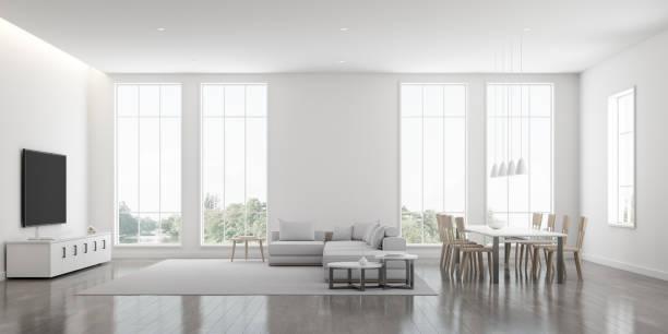Vista de la sala de estar blanca en estilo minimalista con muebles en suelo laminado brillante. Diseño interior con TV y sofá en fondo de árbol. renderizado en 3D. - foto de stock