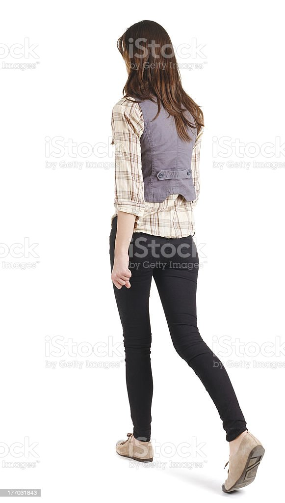 View of woman walking away from camera stock photo