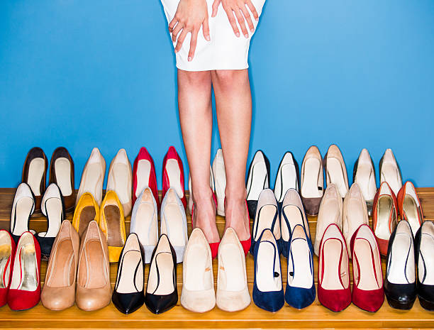 view of woman wearing high heels - shoe stock photos and pictures