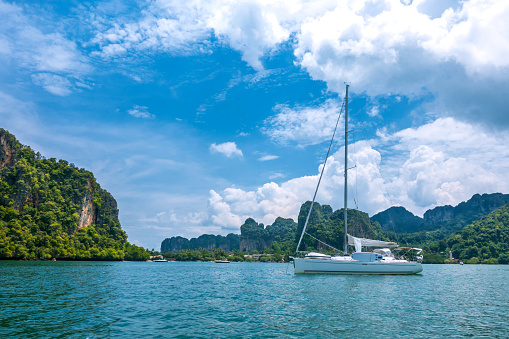 view of yacht floating in the sea in sunny day with blue sky background, Phi Ph Leh, Krabi,Thailand