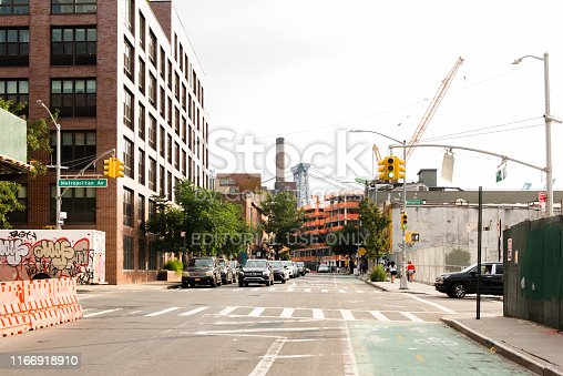 654490824 istock photo Williamsburg, Brooklyn, New York - August 26, 2018. View on a construction and Williamsburg bridge from Metropolitan Avenue in Brooklyn. 1166918910