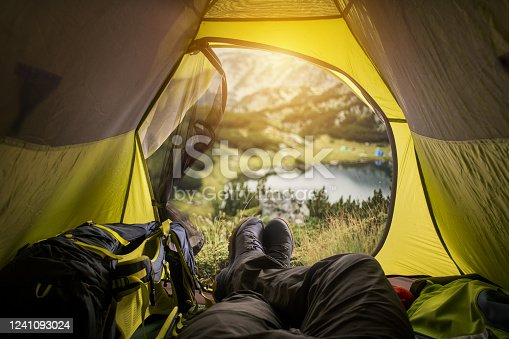 497486952 istock photo View on a lake in the mountains from the tent. Sport and active life concept. 1241093024