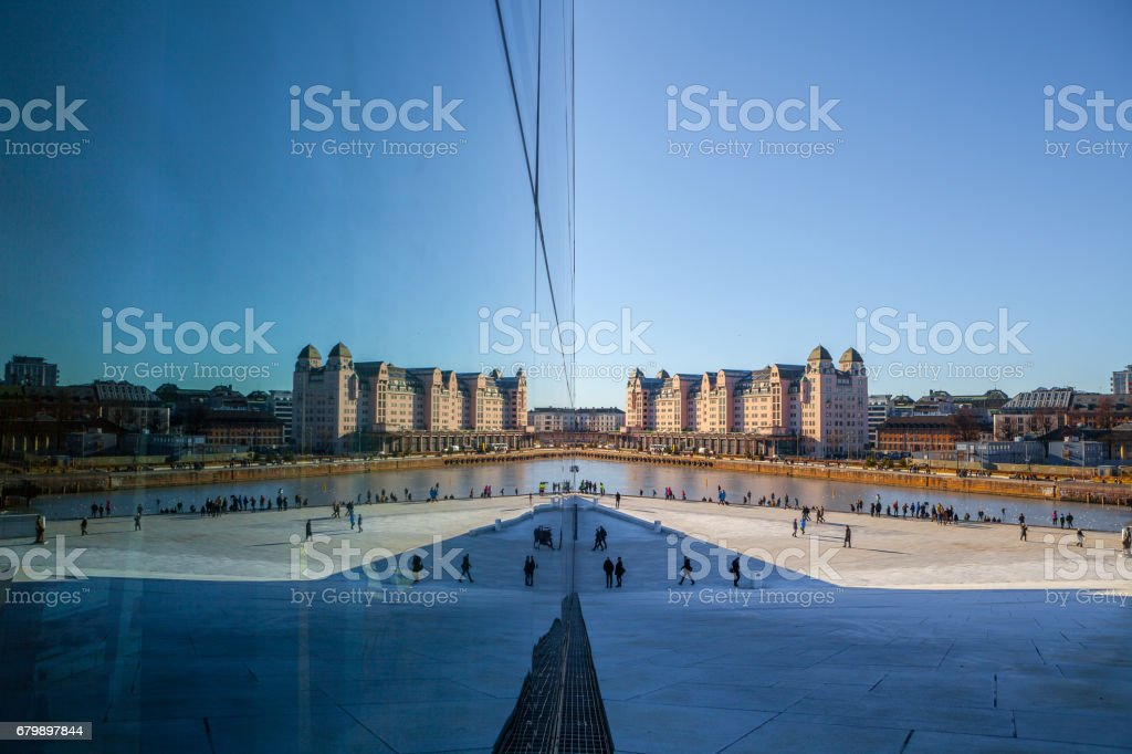 OSLO, NORWAY - 25 FEB 2016: View on a side of the National Oslo Opera House with city reflected in glass stock photo