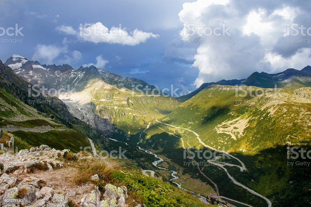 View on Alpine landscape with curved road stock photo
