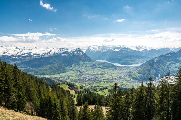 View on amazing snowy swiss Alps as seen from Hochstuckli peak View on amazing snowy swiss Alps as seen from Hochstuckli peak in canton of Schwyz swiss alps stock pictures, royalty-free photos & images