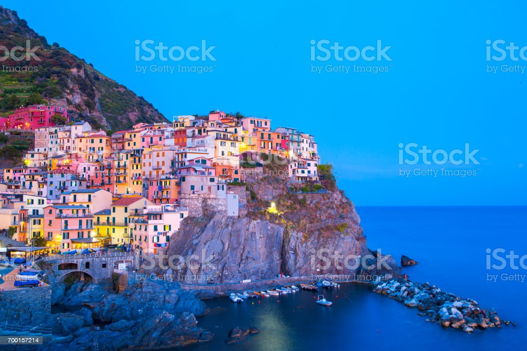 View on architecture of Manarola town in sunset light. Manarola is one of the most popular town in Cinque Terre National park, Italy stock photo