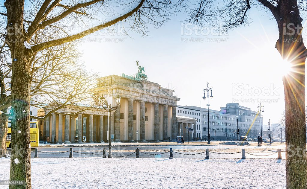 view on Berlin Brandenburger Tor with snow in morning sun stock photo