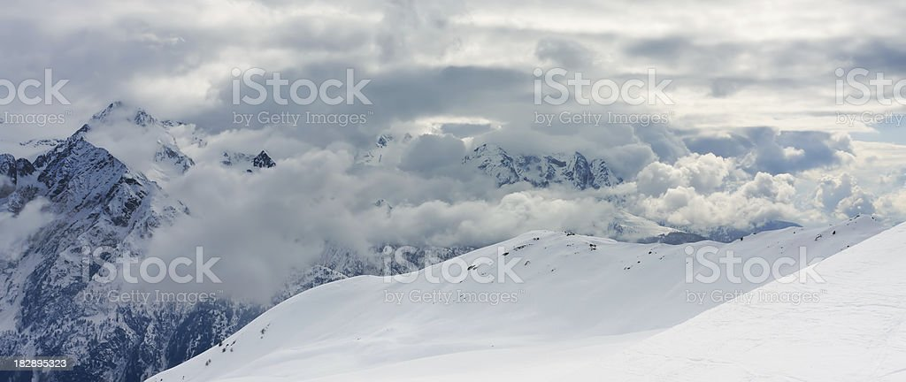 View on beutifull mountains in Italy full of snow stock photo