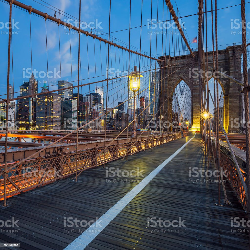 View on Brooklyn Bridge by night stock photo