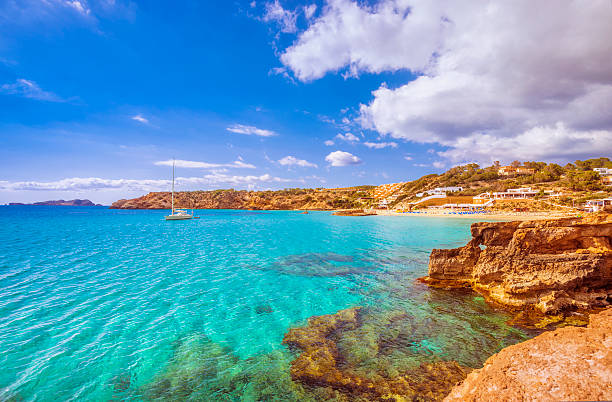 View on Cala Tarida (Ibiza) View on the beautiful beach and bay of Cala Tarida, famous for its clear, sandy, shallow and turquoise waters. ibiza island stock pictures, royalty-free photos & images