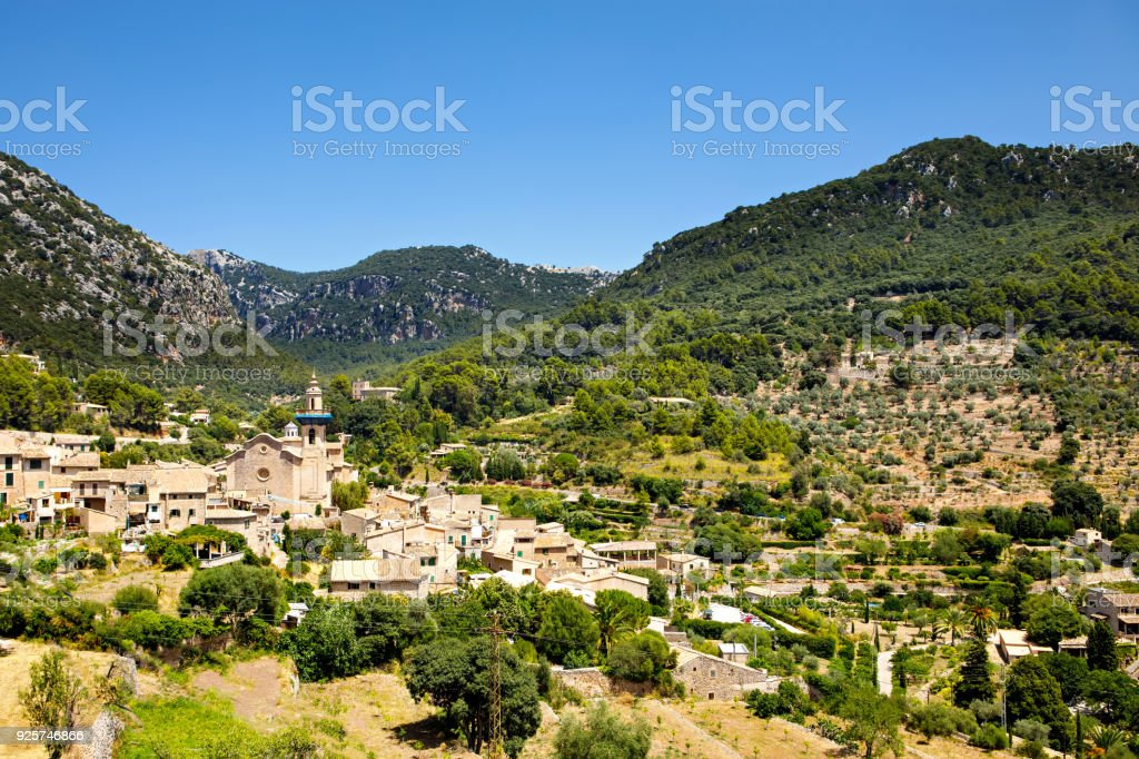 View on city Valldemossa with traditional flower decoration, famous old mediterranean village of Majorca. Balearic island Mallorca, Spain stock photo