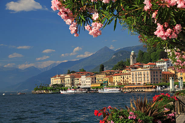 view on coast line of bellagio on lake como, italy - lake como stock photos and pictures