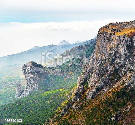 istock View on coast of Black sea in Crimea from mountain peak, cloudy sky 1286810103