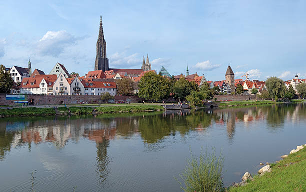 View on Danube River and Ulm Minster, Germany Ulm, view on Danube River, City Wall, old Fishermen's Quarter and Ulm Minster, Germany ulm minster stock pictures, royalty-free photos & images