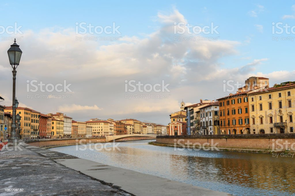 View on embankment of Arno river and bridge Ponte Di Mezzo. Pisa, Italy stock photo