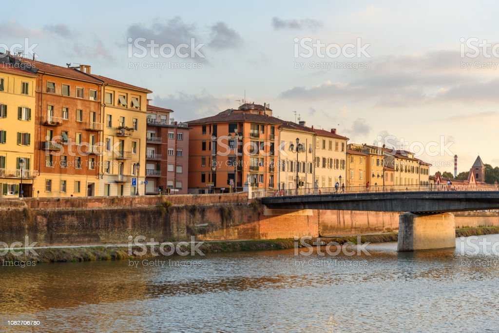 View on embankment of Arno river and Solferino bridge at sunset. Pisa, Italy stock photo