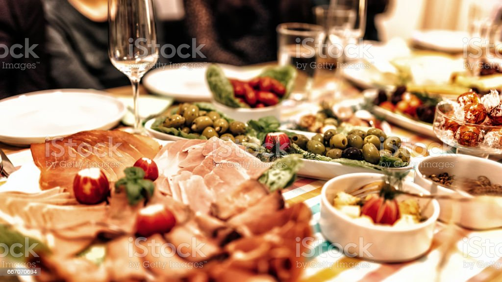 view on festive mediterranean dining table with cold meal stock photo