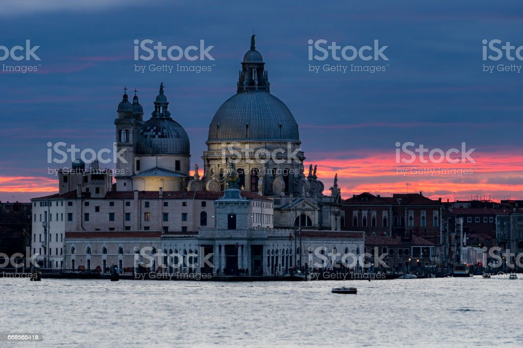View on Grand Canal and Santa Maria della Salute basilica at sunset in Venice, Italy stock photo