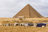 Cairo, Egypt - December 8, 2018: View on great pyramid of Cheops and Sphinx in Giza plateau. Cairo, Egypt