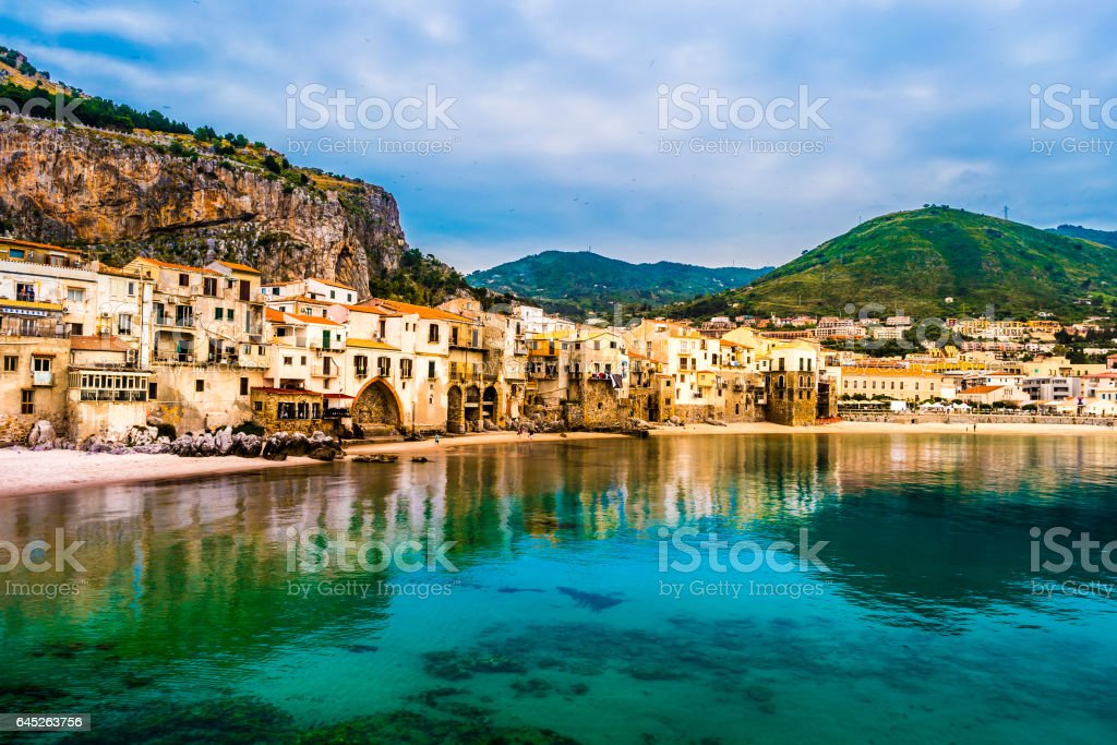 View on habour and old houses in Cefalu at night, Sicily stock photo