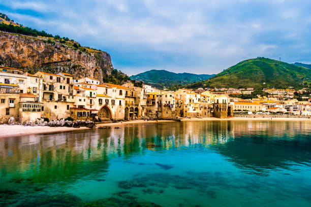 View on habour and old houses in Cefalu at night, Sicily - foto stock