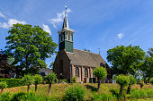 Grootschermer, The Netherlands - May 31 2020: \nThis reformed church is a three-sided closed hall church with wooden tower above the west facade was renewed for the third time in 1762.