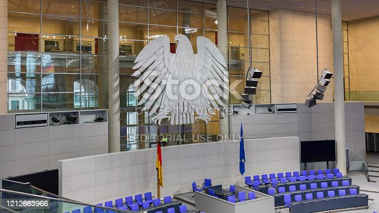 istock View on interior of the empty plenary hall of the German Federal Parliament (Deutscher Bundestag). 1212663966