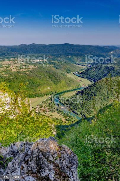 Photo of View on Kolpa river from Kozice mount, Bela Krajina, Slovenia.