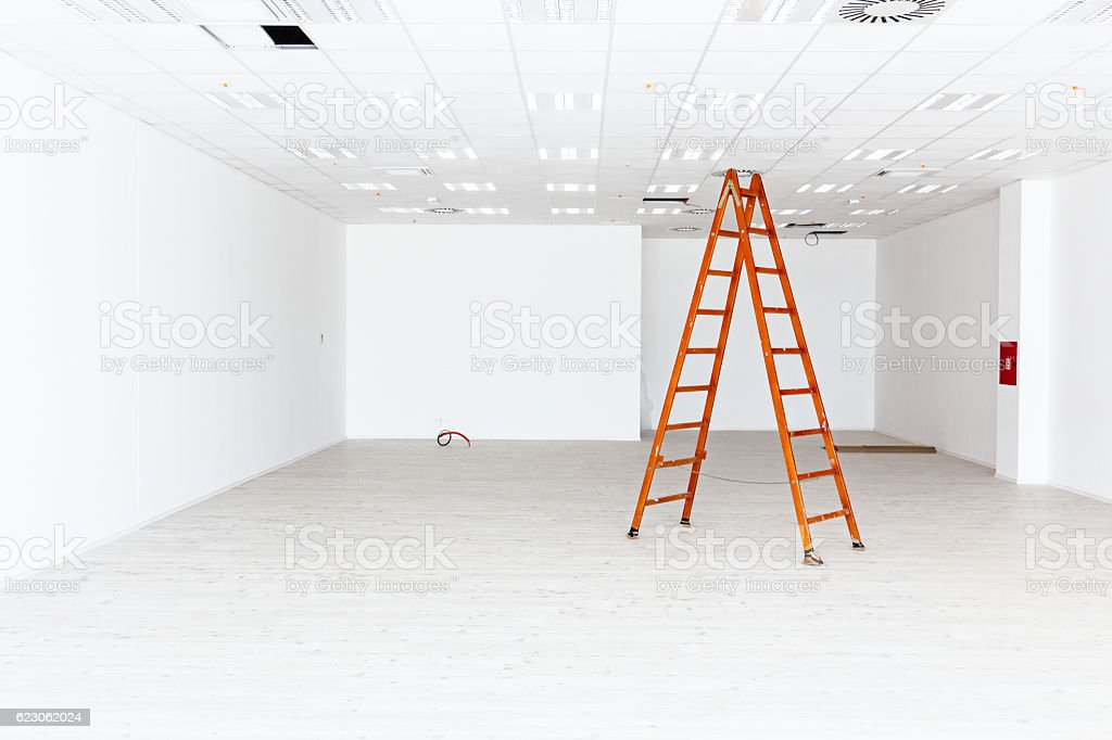 View on large white and empty showroom with hardwood floor. stock photo