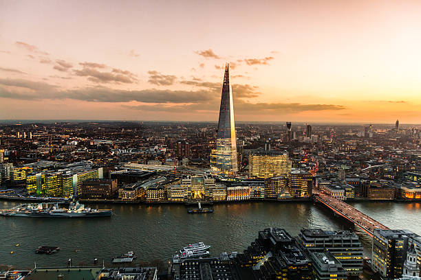 view on london at sunset, vibrant sky. - shard london bridge stockfoto's en -beelden