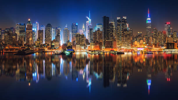 View on Manhattan at night Panoramic view on Manhattan at night, New York, USA new york state stock pictures, royalty-free photos & images