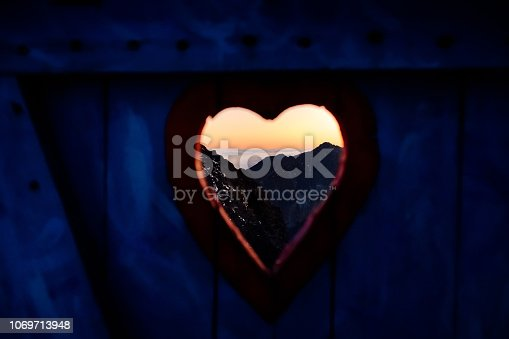 istock View on mountain landscape through door 1069713948