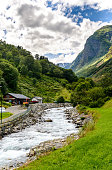 View on Mountainriver in Undredal with cloudy sky, nearby Naerofjord,  Gudvangen, Flam. Norway.