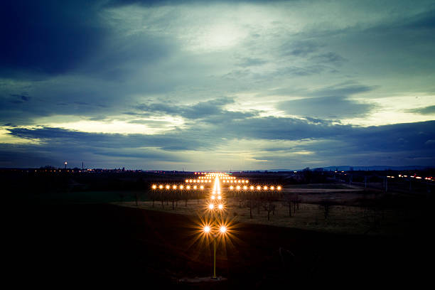 view on navigation lights at dusk - vliegveld stockfoto's en -beelden