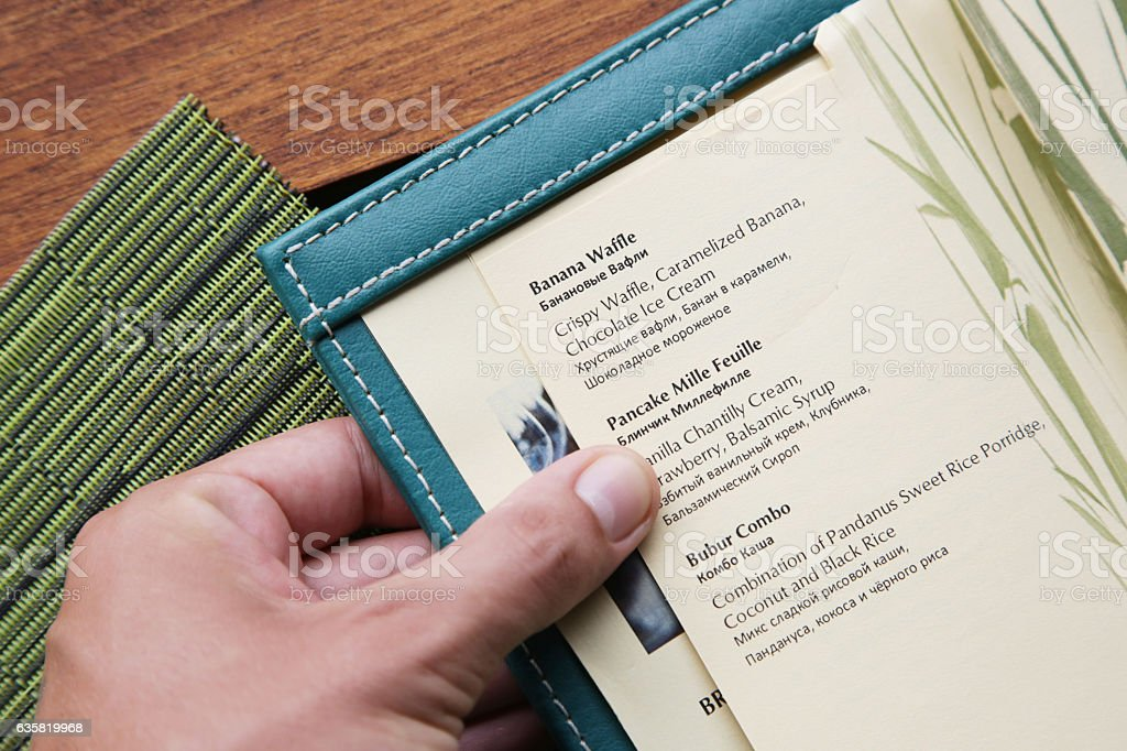 View on opened menu book stock photo