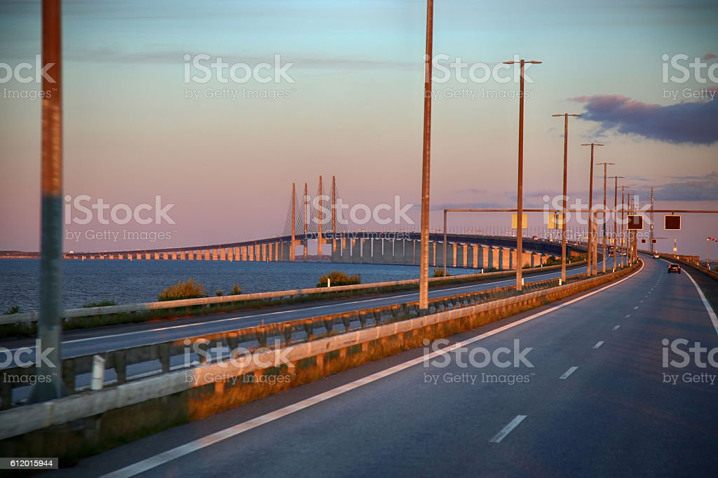 View on Oresund bridge between Sweden and Denmark at sunset stock photo