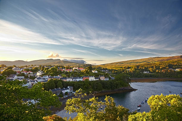 view on Portree, Isle of Skye, Scotland view on Portree with the Old Man of Storr on background, Isle of Skye, Scotland isle of skye stock pictures, royalty-free photos & images