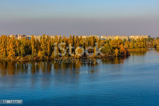 View on residential buildings of city Kremenchug and river Dnieper on autumn