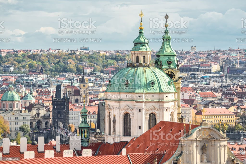 View on roof of ancient Saint Francis of Assisi Church and Old Town. St Francis of Assisi boasts the second-oldest organ in Prague, Czech Republic stock photo