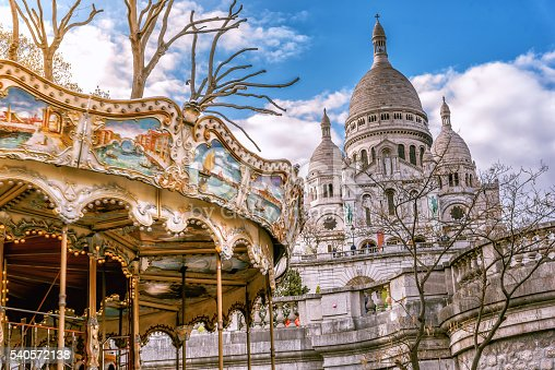 view on Sacre Coeur with old caroussel